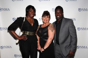 T.E.A.M. member Samantha Bennett with Shola and Deion Branch. The Deion Branch Foundation supports organizations committed to assisting those affected by meningitis, including NMA. Photo by R.Cole for Rob Rich/SocietyAllure.com © 2015